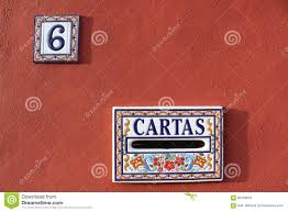 cartas mailbox and house number plate in spain colorful red white