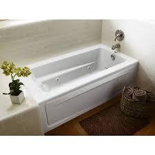 heated soaking tub kohler reversible drain soaking tub in dune