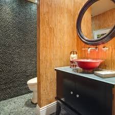rock wall bathroom bathroom rustic with wood floor knotty pine rock wall bathroom bathroom asian with stone wall wall mount faucet round mirror