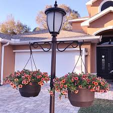 fieldsmith solar powered lamp post light with planter base and led