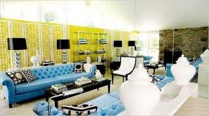 yellow brown wall room completed with long blue tufted sofa