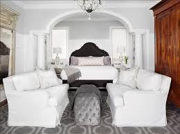 beautiful ethereal bedroom features gray velvet headboard with