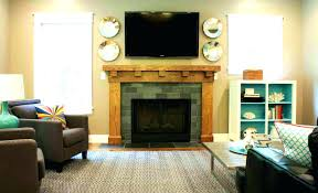 decorating ideas over fireplace mantel above candles brick