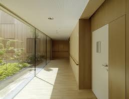 prefab timber nursing home uses passive design to bring light and