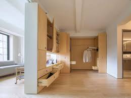 400 square foot apartment uses clever pivot wall to divide space
