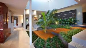 interior natural indoor garden decor with natural waterfall and