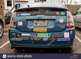 toyota motors usa toyota prius hybrid car with many bumper stickers usa stock