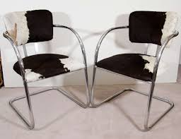 furniture set of two black and white cowhide chairs chrome base