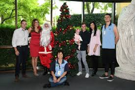 tommy berry plays santa at the sydney children u0027s hospital