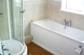 holiday apartment newquay within the bathroom there is a quadrant shower cubical wash basin and wc also there is a carronite double ended bath with central taps the carronite bath