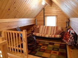 stunning log cabin futon using striped upholstery fabric alongside
