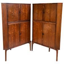 pair of mid century modern danish rosewood corner cabinets or bars