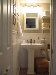 Very Small Bathroom Storage Ideas A Shallow Shelf Above The Sink Adds Storage And Display Space