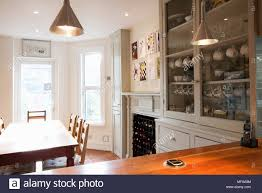 dining table in front of fireplace view across wooden worktop to dining table and chairs in front of