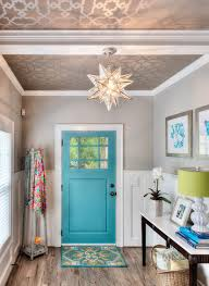 25 gorgeous entryways clad in wallpaper metallic wallpaper on the ceiling and a splash of blue aim to bring mediterranean charm to