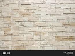 pattern of white modern stone brick wall surfaced stock photo