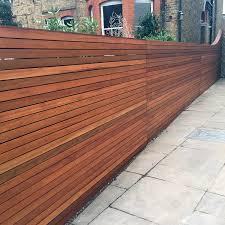 contemporary wood grain vinyl fence for easy on the eye filler