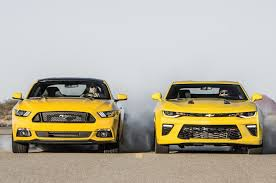 car and driver mustang vs camaro 2016 chevrolet camaro ss vs 2016 ford mustang gt 2