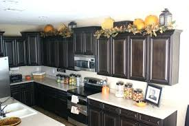 Decorations On Top Of Kitchen Cabinets Kitchen Cabinet Top Decoration Decorating Above Cabinets Board On