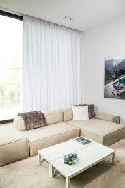 a spacious living room aristide