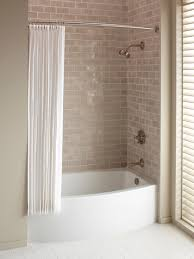 soaking tub in small bathroom with shower and