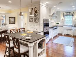 kitchen cottage kitchen with a dining table and chairs and