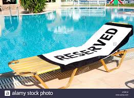 Beach Lounger A Beach Towel With The Word U0027reserved U0027 Spread Onto A Sun Lounger