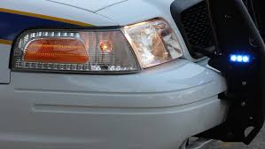 strobe lights for car headlights police car headlight and grill guard strobe flashing closeup early