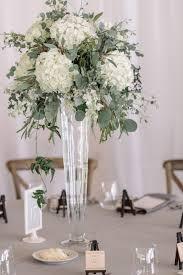 White Hydrangea Centerpiece by Pilsner Vase With White Hydrangea Eucalyptus Dusty Miller
