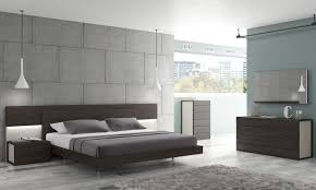 dark grey wooden bed with headboard and bedside table connected by