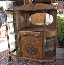 antique curio this piece has it all side board curio cabinet