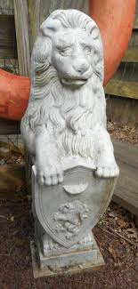 statue lions pair of cast iron lion statues holding a shield for sale at 1stdibs