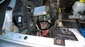 hooking up a backup reverse camera to the wiring under the hood