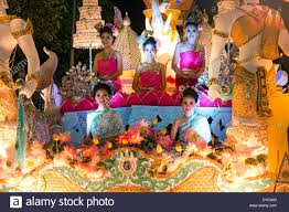 Festival Of Lights Thailand Women In Traditional Costume Travelling On A Float Parade Loi