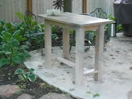 ana white farmhouse table modified to become an outdoor kitchen