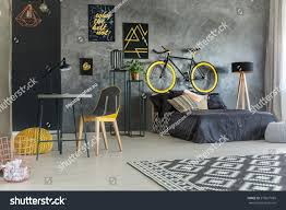 grey student room bed desk bike stock photo 575877685 shutterstock