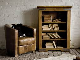 Natural Wood Bookcase Incridible Tan Leather Oversize Chair Beside Classic Wood 4 Shelf
