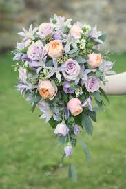 teardrop bouquet in peach and lilac with vuvuzela and ocean song