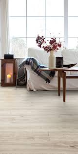 Majestic Baby Grand Laminate Flooring Living Room Featuring Secura Pur Luxury Vinyl Sheet Flooring In