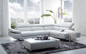 Modern Comfortable Couch L Shaped Cream Fabric Sofa With Cushions Placed On The Brown