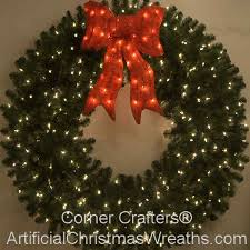 beautiful looking large wreaths lighted outside