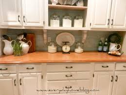 budget friendly painted brick backsplash at everyday home