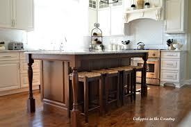 stained kitchen cabinets with hardwood floors tile vs hardwood floors in the kitchen calypso in the country