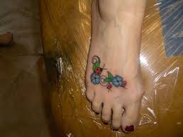 Ladybug And Flower Tattoos - blue flowers n ladybug tattoo on right foot photos pictures and