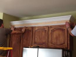 how to make cabinets appear taller mostly diy kitchen cabinet transformation the process
