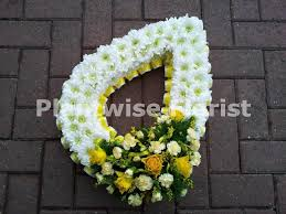 based teardrop funeral flowers wreath plantwise florist canvey
