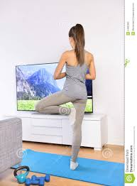 yoga video woman training in home living room stock photo image
