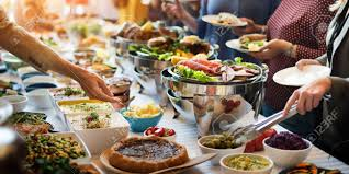 food buffet catering dining eating party sharing concept stock