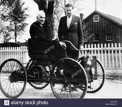 first car ever made with engine henry ford sits in his first ford car built in 1896 as his