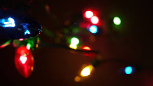 cost of christmas lights traditional string of multi coloured christmas lights blurred